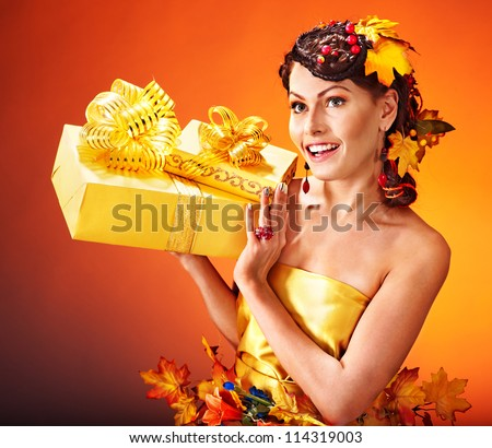 Woman with  autumn hairstyle  holding gift box.