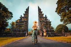 Woman with backpack exploring Bali, Indonesia.