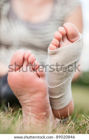 Woman with bandaged foot