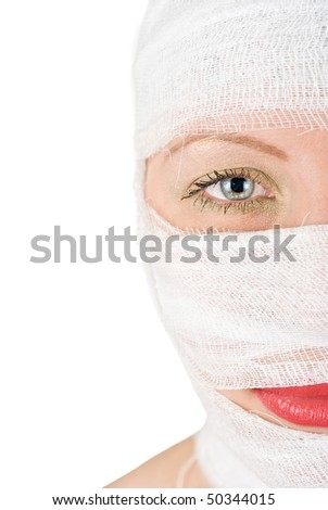 woman with bandages on her face half portrait on white