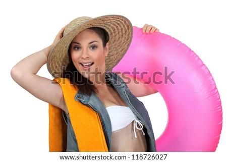 Woman with beach equipment