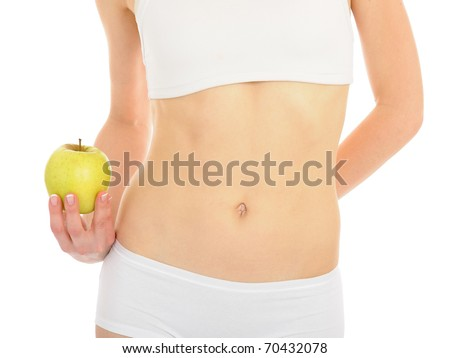 woman with beautiful body holding an apple near the slim waist. isolated on white background