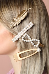 Woman with beautiful different hair clips, closeup