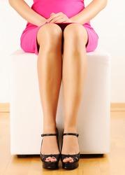 Woman with beautiful legs sitting