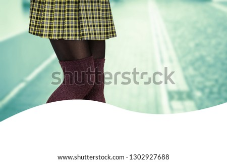 Woman with beautiful legs wearing mini skirt and knee high socks #1302927688
