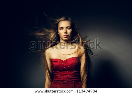woman with beautiful long hair on wind