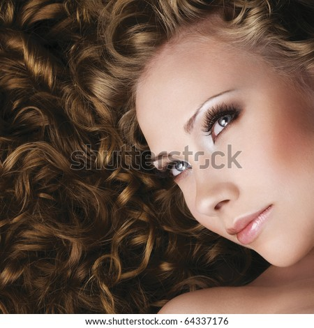 Lifestyle Stock-photo-woman-with-beautiful-makeup-and-long-curly-hair-64337176