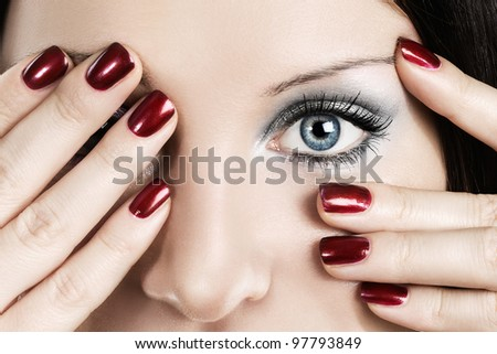 Woman with beautiful makeup and manicured nails