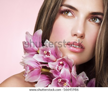 Woman with beautiful makeup and pink orchids