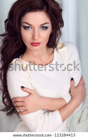 Woman with beauty long brown hair  posing at home studio