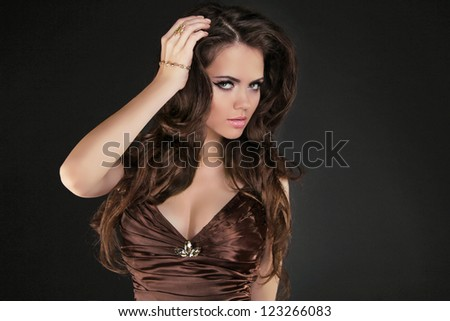 Woman with beauty long brown hair, posing at studio