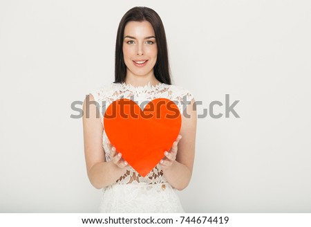 Woman with big red heart cartoon over light background. #744674419