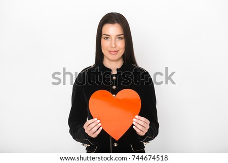 Woman with big red heart cartoon over light background. #744674518