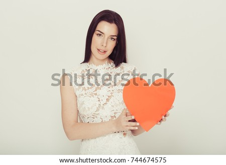 Woman with big red heart cartoon over light background. #744674575