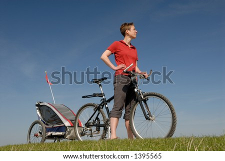 Woman with bike and trailer