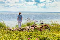 Woman with bike at seaside