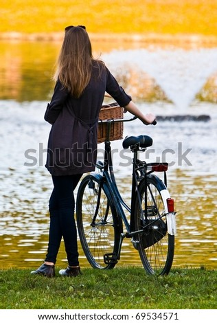 Woman with bike in park