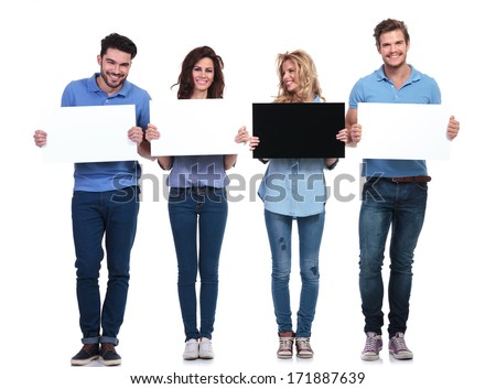 woman with black card looking to her side at her friends who hold white ones