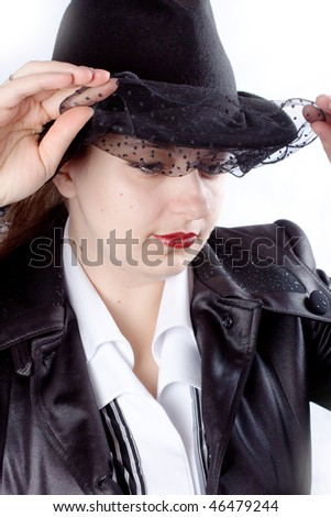 woman with black coat and hat