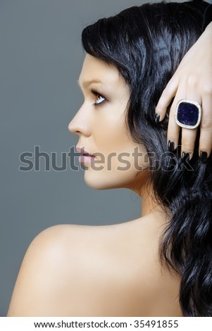woman with black hair and ring on black manicure hand, from 16Bit RAW