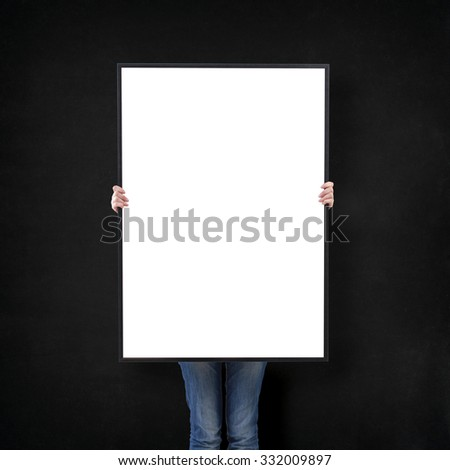 woman with blank poster on wall background #332009897