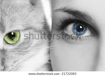 woman with blue eyes and cat with green eyes