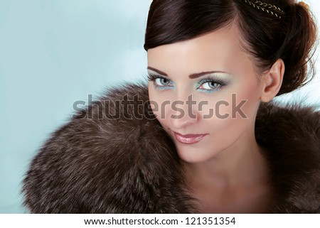 Woman with blue eyes, Winter Girl in Luxury Fur Coat - stock photo