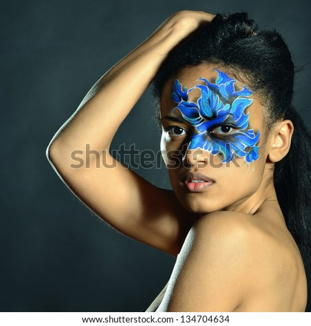 Woman with blue face-art
