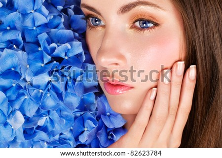 Woman with blue flowers
