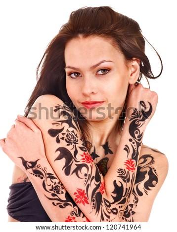 Stock Photo Woman with body art against graffiti brick wall.