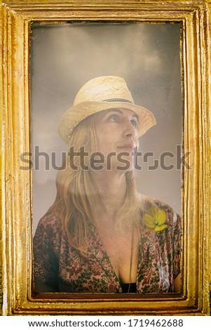 woman with borsalino hat and yellow poppy Stock photo ©