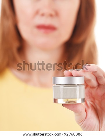 woman with bottle of cream - Shutterstock ID 92960386