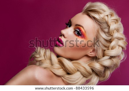 woman with bright creative make up and with the magnificent scythes from the hair