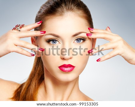 Woman with bright red lips and nail