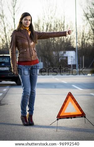 Woman with broken car seeking help