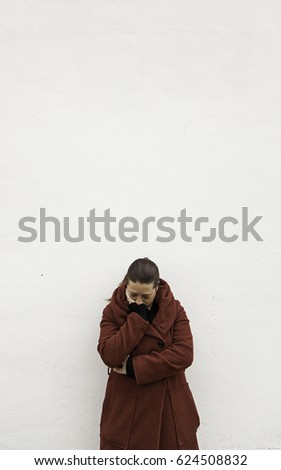 woman with bruised eyes in...