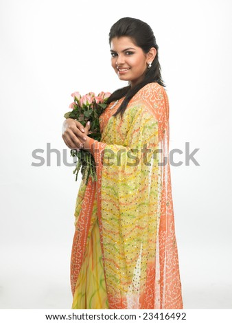 Woman with bunch of pink roses