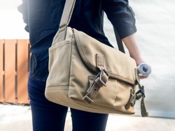 Woman with canvas shoulder bag.Concept of messenger,student,traveler
