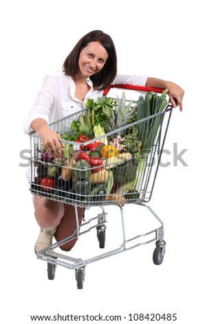 Woman with cart full of vegetables