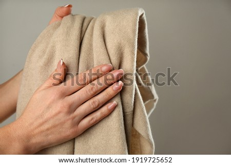 Woman with cashmere sweater on beige background, closeup Сток-фото ©