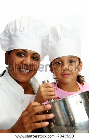 Woman with child teaching her to cook