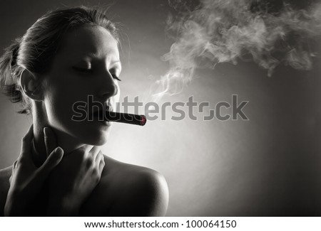 Woman with Cigar Exhaling Smoke. Black and white photo
