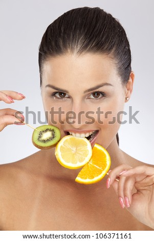 Woman with citrus fruits