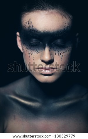 Woman with closed eyes and bright make-up.Halloween