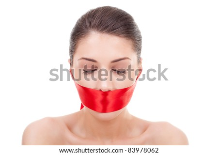 woman with closed eyes and mouth covered with a red ribbon over white background