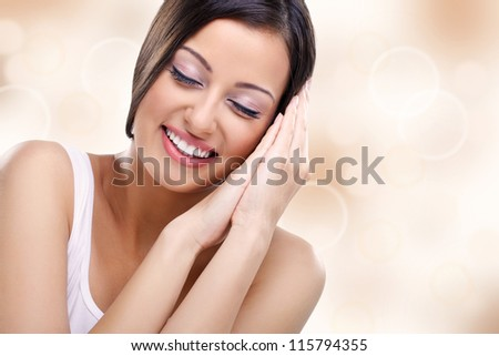 Woman with closed eyes enjoying in her healthy skin