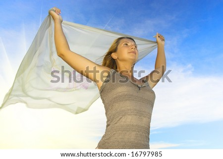 Woman with cloudy sky background and sunlight