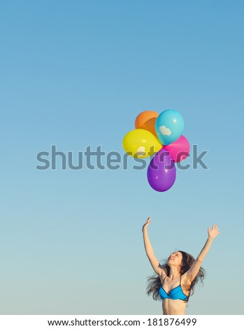 Woman with colorful balloons. Place for text.