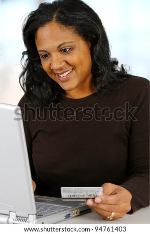 Woman with computer set in her home