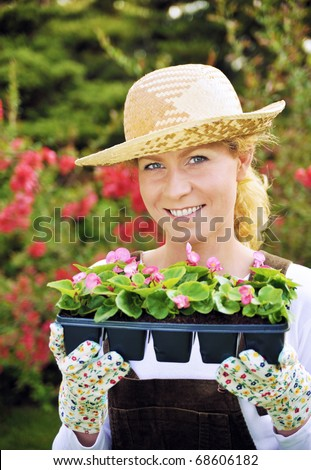 Woman with container-grown plants